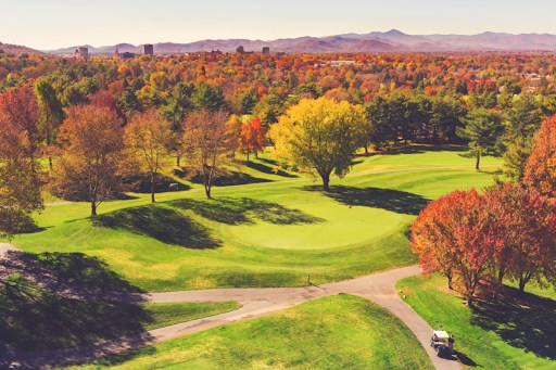 Aerial view of a golf course in autumn.