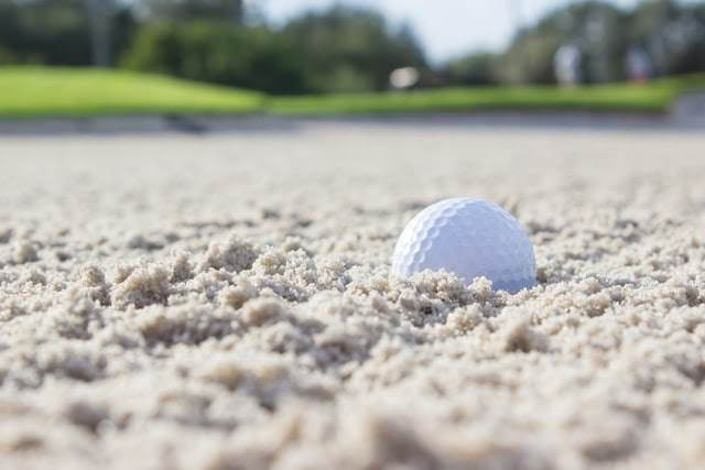 Golf ball in a sand trap.